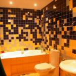 Ванная комната в черно оранжевом цвете